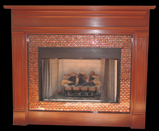 Artistic mosaic and fused glass tiles to cover a fireplace surround