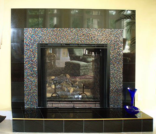 Artistic mosaic and fused glass tiles to cover a fireplace surround  Designer Glass Mosaics