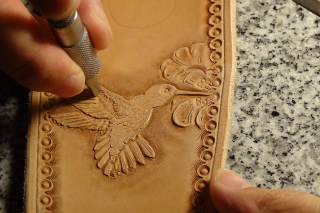 CT Strickland Handcarving a Hummingbird in Leather