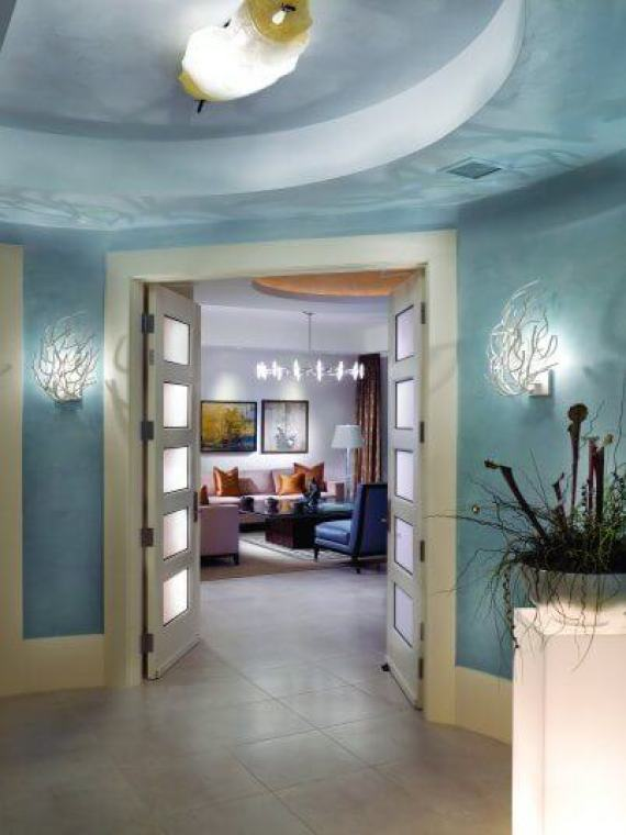 This stunning entrance was inspired by the ocean. Even the paint is darker on the bottom and lightens as it goes higher - just like the ocean.