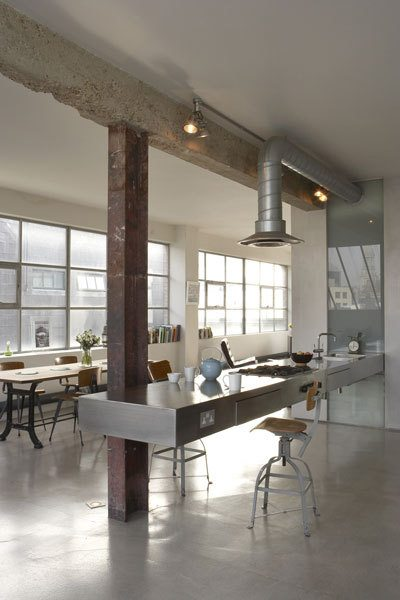 Kitchen with concrete counters and raw beams