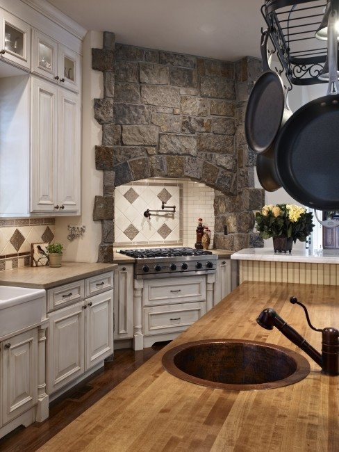kitchen with stone hearth and butcher block counters