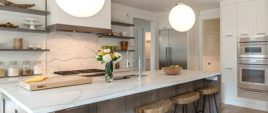 Kitchen with Thermador appliances, marble countertops and floating shelves