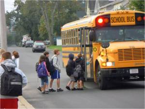 kids getting on yellow school bus