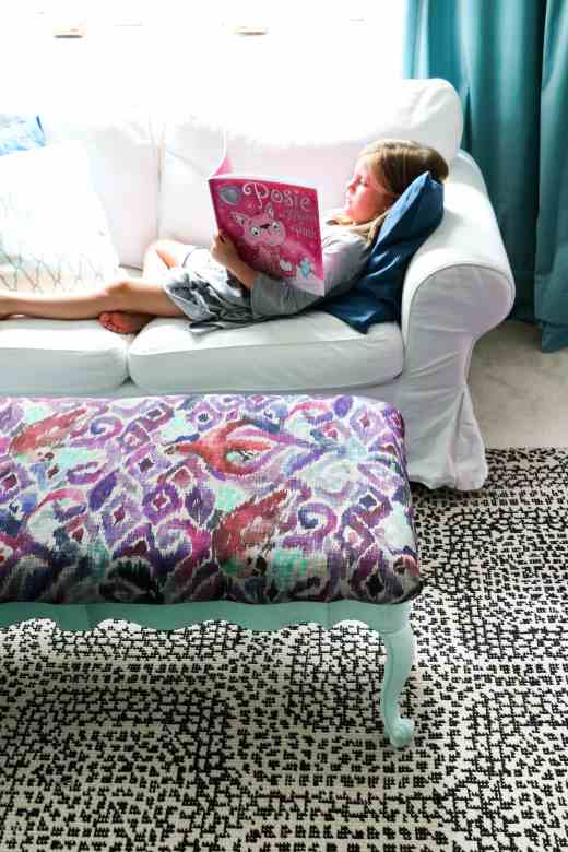 Girl reading in a colorful room