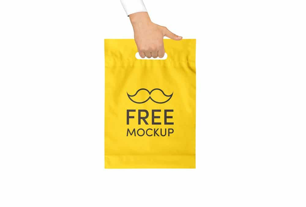 All bags are customizable from all sides. Hand Holding Yellow Plastic Bag Free Mockup Designhooks