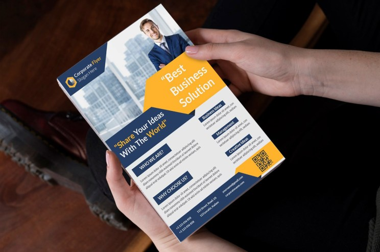 Person Holding Flyer Mockup - Realistic Free Flyer Mockups PSD