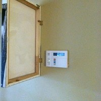 Tuesday's Tips: Hide thermostats, firepulls & alarms with hinged canvas art...