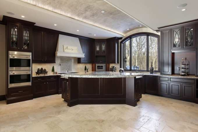 Large Dream Kitchen With Dark Wood Cabinets And White Granite Countertop Island In Custom Home