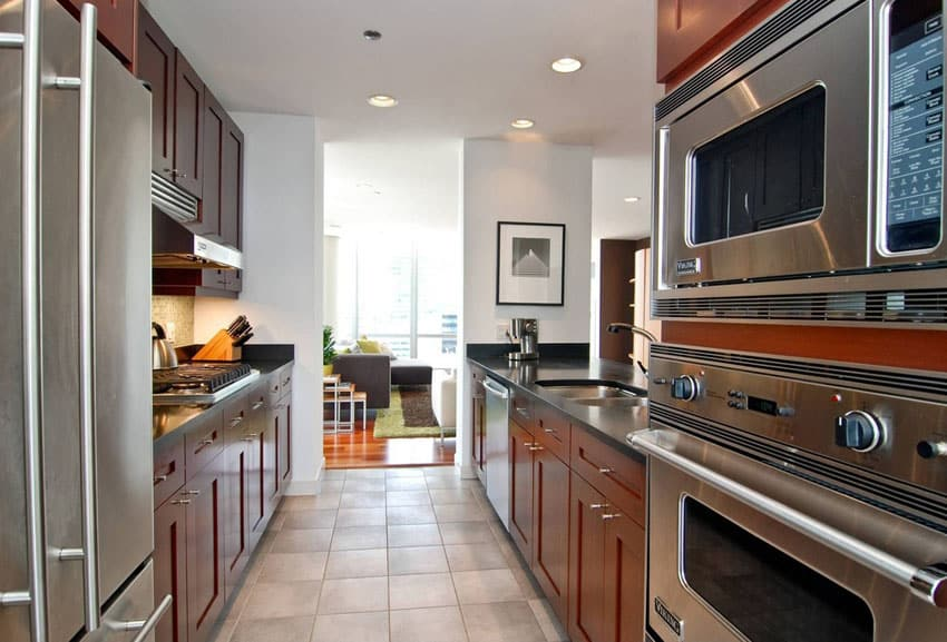 A section of continuous countertop at least 30 wide with a permanent or adaptable knee space should be included somewhere in the kitchen. 25 Stylish Galley Kitchen Designs - Designing Idea