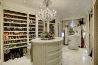 classy master closet with island  Roselawnlutheran