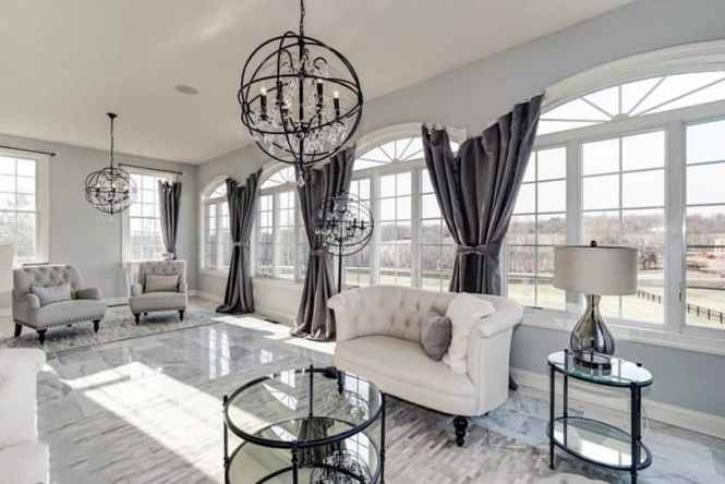 Beautiful Living Room With Tile Floors Dark Curtains And Round Modern Chandelier Lighting