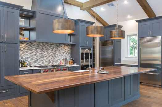 Contemporary Kitchen With Dark Blue Cabinets Large Island Wood Counter And Bronzed Drum Pendant