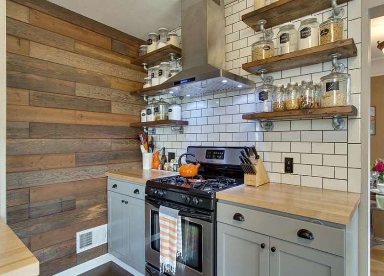Small rustic kitchen with open shelving with glass jars