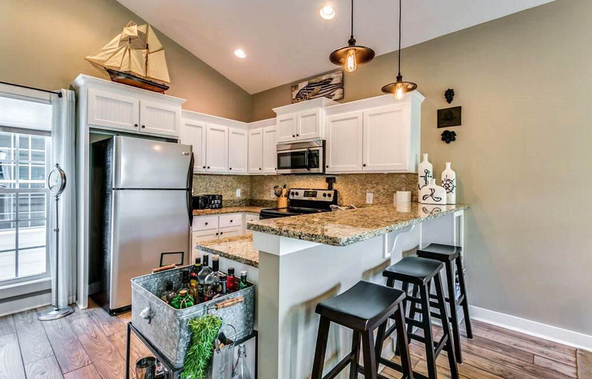 Decorating Ideas for the Space Above Kitchen Cabinets