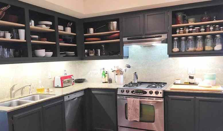 Black kitchen with open shelving by removing doors