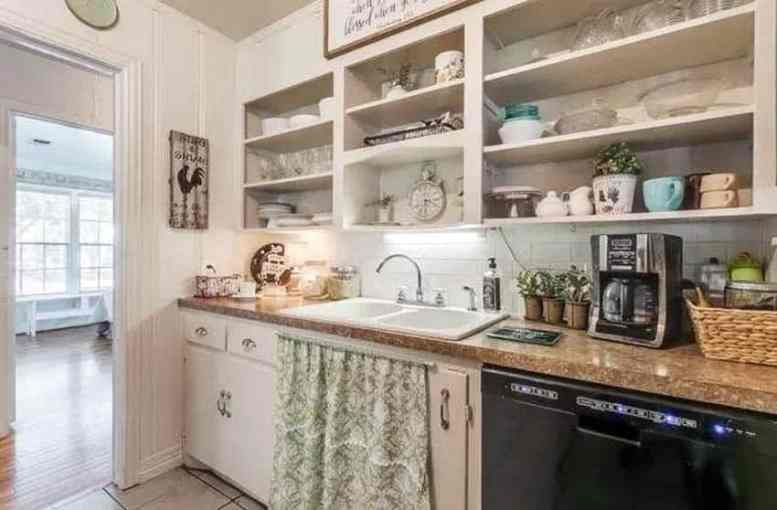 Country kitchen with open shelving white subway tile backsplash