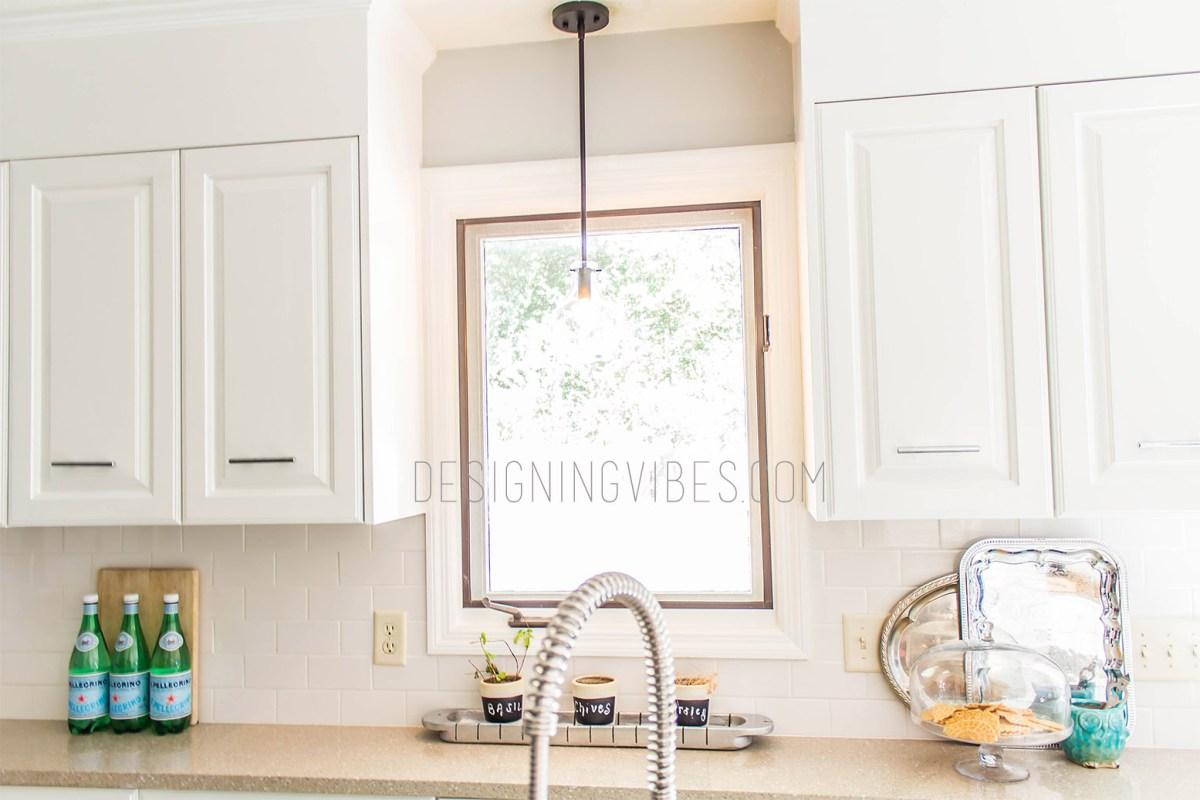 white kitchen cabinets with white subway tile backsplash