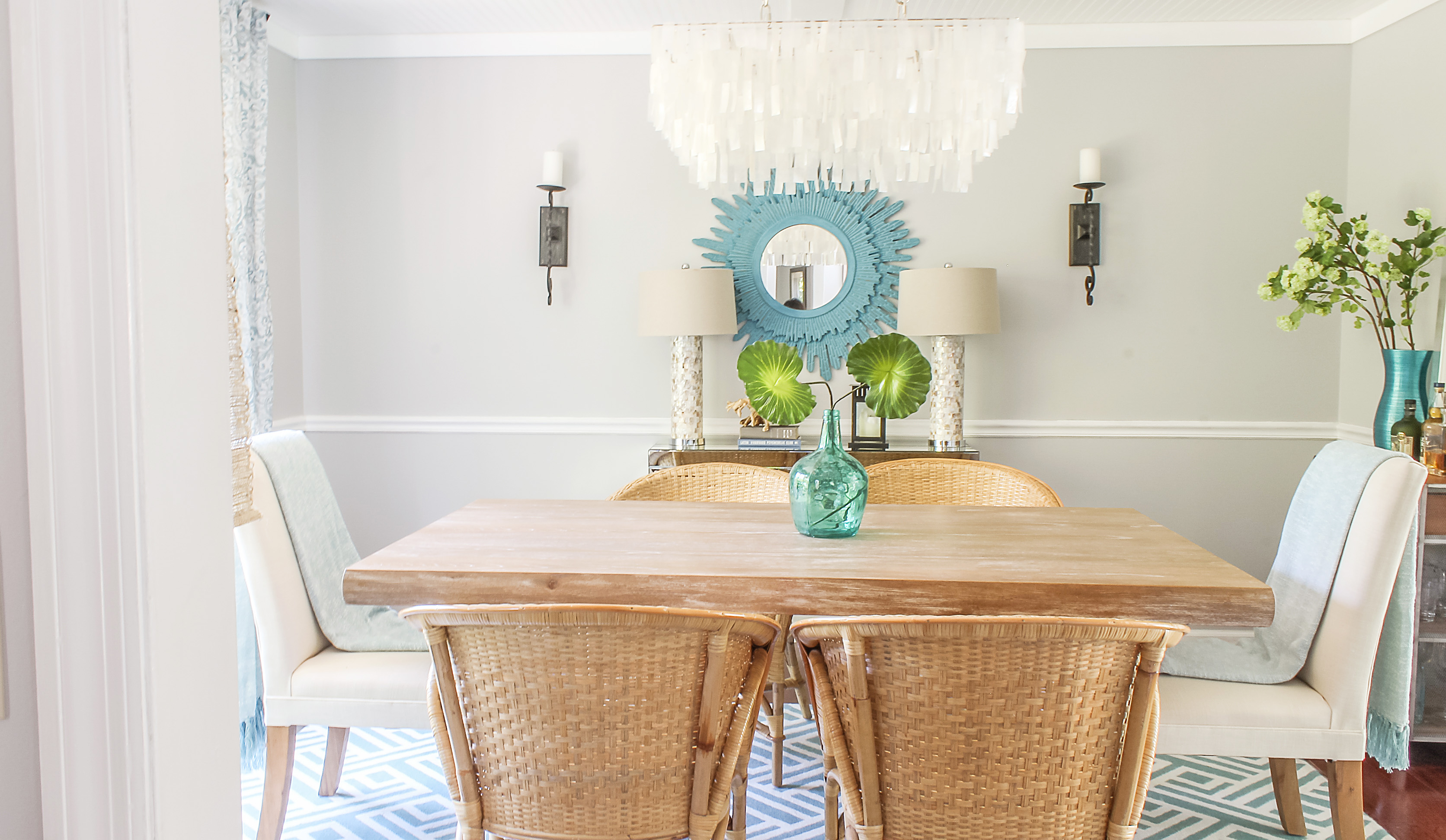 Rattan Chairs In Modern Transitional Dining Room