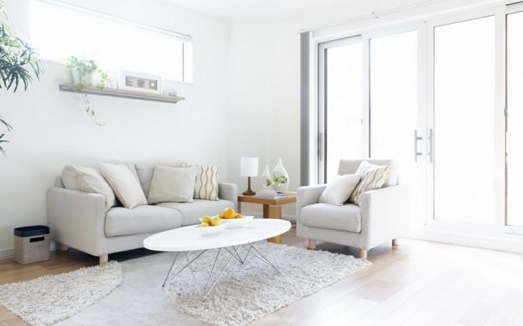 deco salon blanc tapis de sol fleurs coussin canape table basse design fauteuil