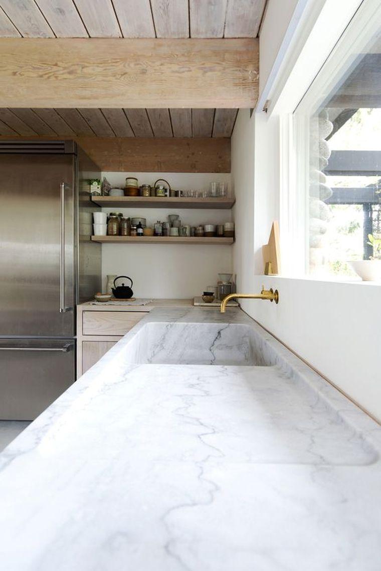 Plan de travail marbre pour une cuisine pleine de caractre