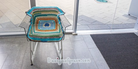 Re-cycled trolley made into a chair covered  in the top and middle section with crocheted rug