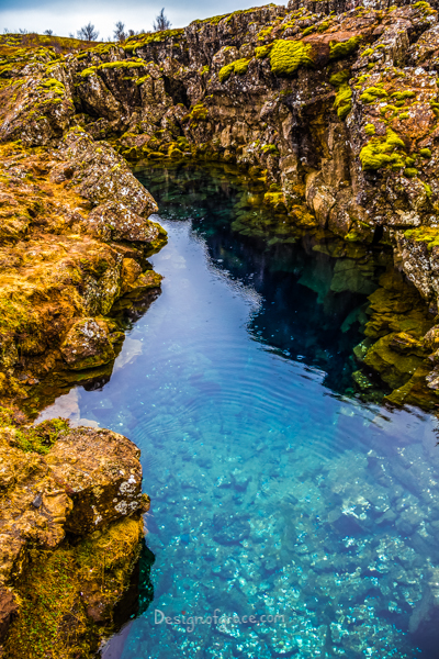 beautiful blue waters in a pool in Iceland surrounded by rock structures