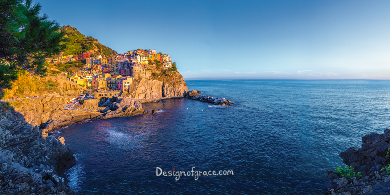beautiful panorama of the town of Corniglia on the left in cinque terra and water on the right.
