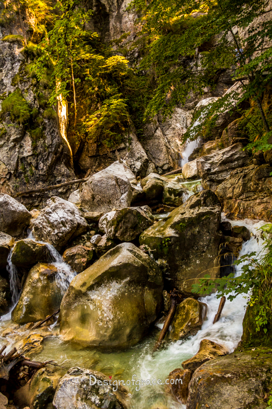 Waterfall with rocks surrounding during Hike up to Neuschwanstein Castle, Bavaria, Germany