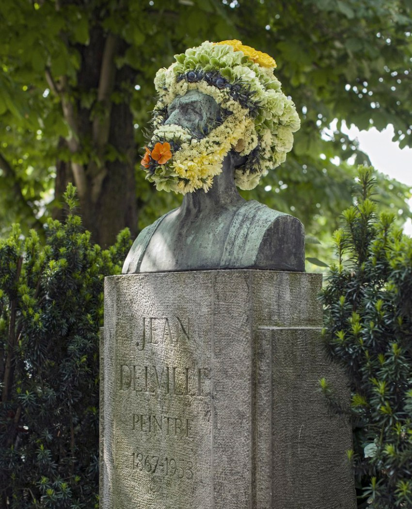 Floral Designer decorates statues with flower beards