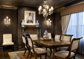 Such a great dark brown dining room with some more WOW artwork