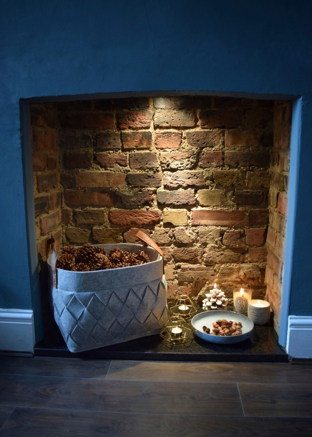 Winter Styling with Cox & Cox, fireplace pinecones storage basket candles hygge