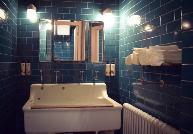 Chiswick fire station decor pink blue tiled retro bathroom
