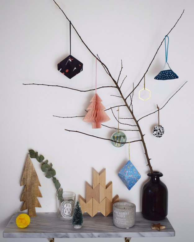 christmas-styling-branch-decoration-with-geometric-and-origami-baubles-donna-wilson-paper-tree-honeycomb-scandi-pastels.jpg