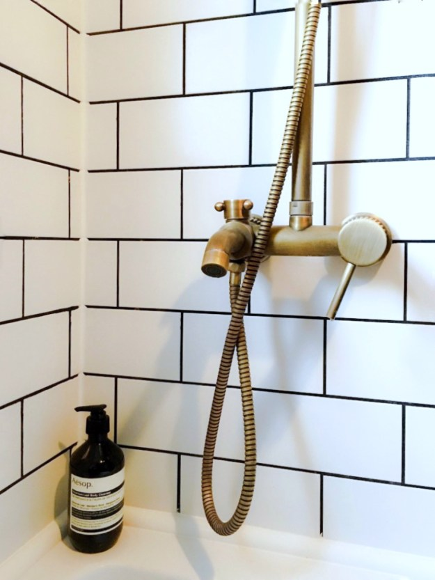 home interior decor ideas metro-tile-brass-bath-fitting-bathroom