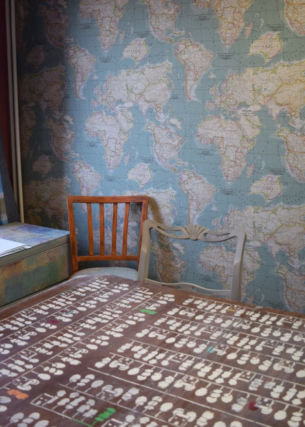 Annie Sloan office workroom, world map wallpaper, stenciled upcycled table