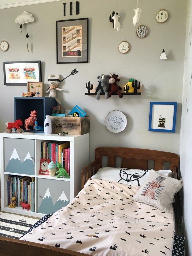 Farrow Ball cornforth white, interior ideas, childrens room decor with a vintage and wooden toys, ikea kallax hack with hand painted mountains ferm living bedding