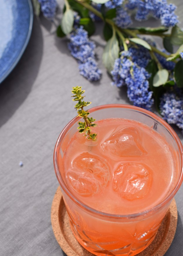 Favourite Summer Cocktail recipe - Gin, St Germain, blood orange, ginger ale and lime with lemon thyme garnish