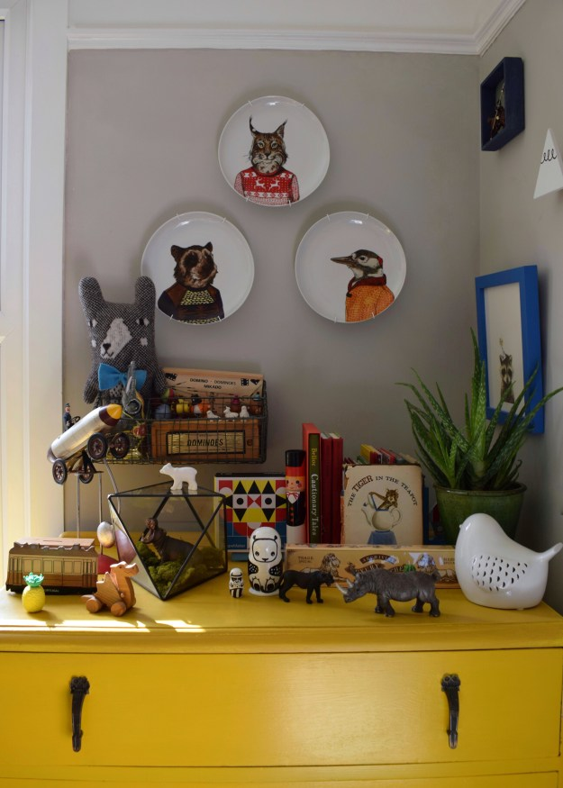 eclectic vintage colourful kids space interior design ideas, kooky animal plates west elm, grey and yellow, terrarium, vintage books and trinkets, monochrome toys