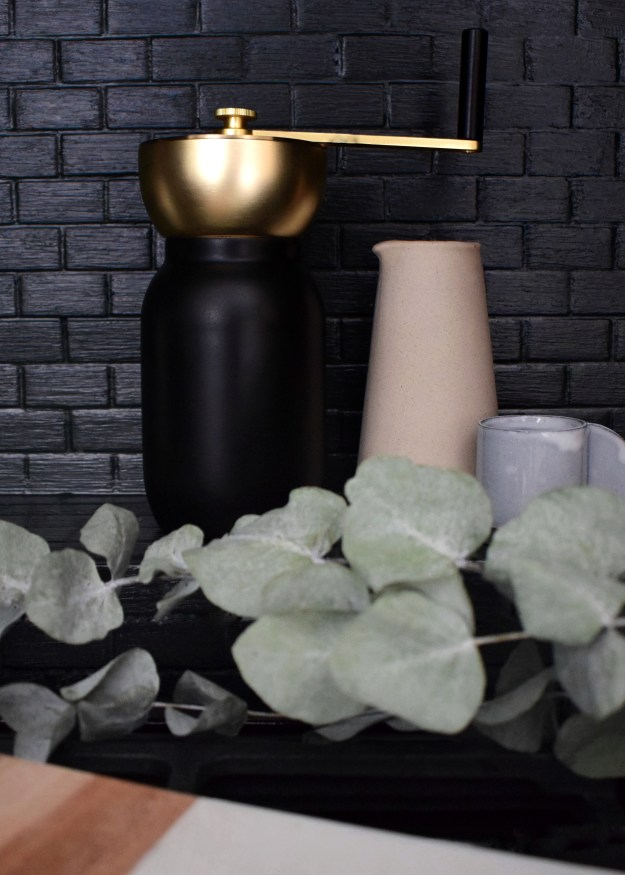 Kitchen Farrow ball studio green, Scandinavian rustic artisan design and styling accessories, Stelton Collar Coffee Grinder brushed brass with ceramics stoneware and marble, styled with eucalyptus (1)