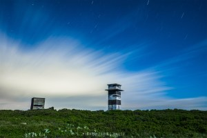 Star trails can be seen as a storm rolls in at Gooseberry Island in Westport, MA