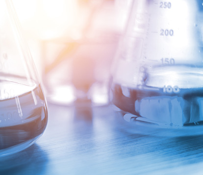 Close up view of two beakers of water in a lab