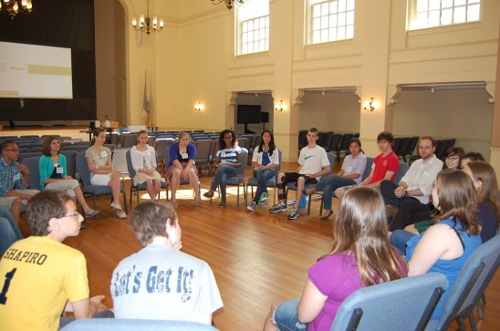 Students seated in a circle