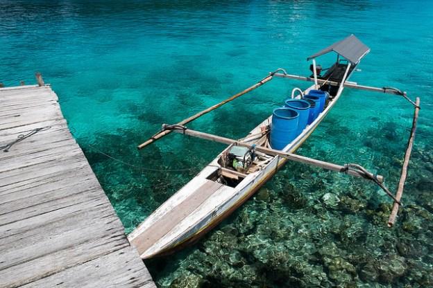 Boat at the jetty at Poya Lisa resort
