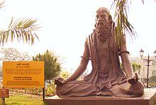 A statue of Patañjali practicing dhyana in the Padma-asana at Patanjali Yogpeeth.