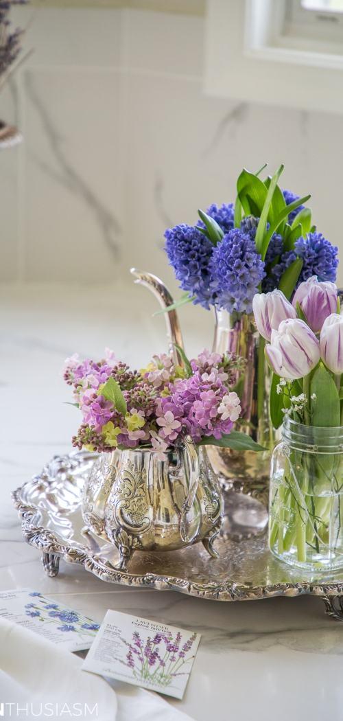 summer refresh bathroom decor flowers on a silver tray