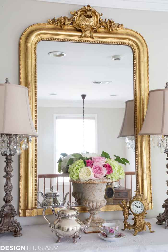french country house with gilded mirror