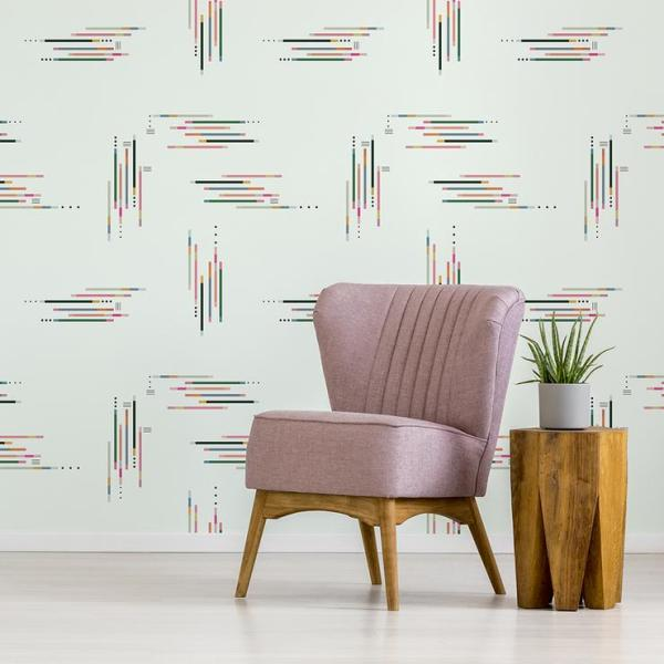 Retro chair with pastel pink upholstery and a wooden table in an empty room interior with white walls and copy space