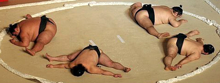 Sumo wrestlers stretching
