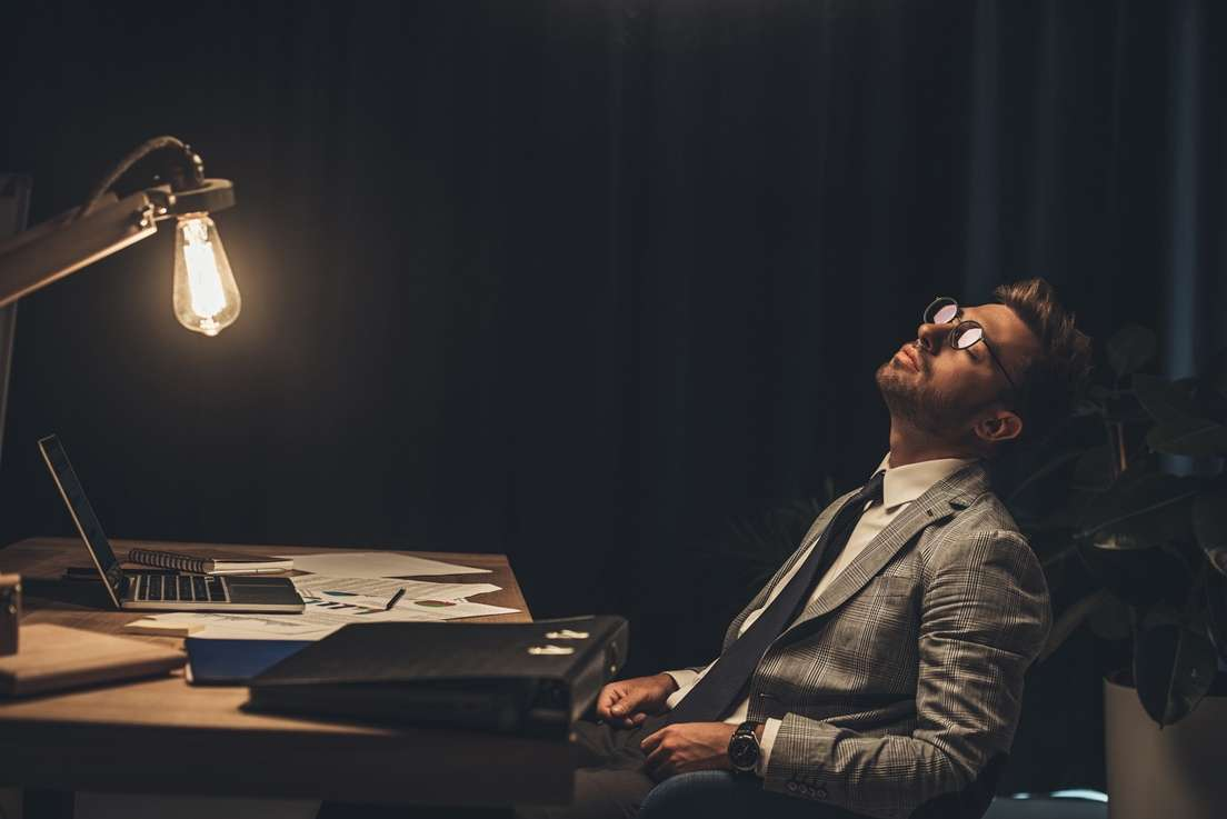 Sleeping Businessman working late during the Pandemic